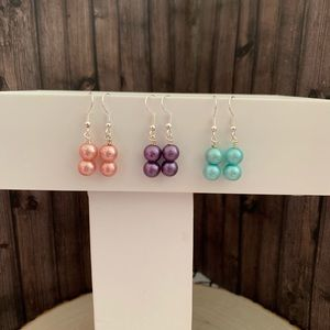 Three pairs of double layered pearl earrings